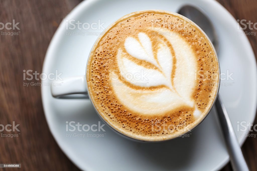 Cup of art latte or cappuccino coffee stock photo