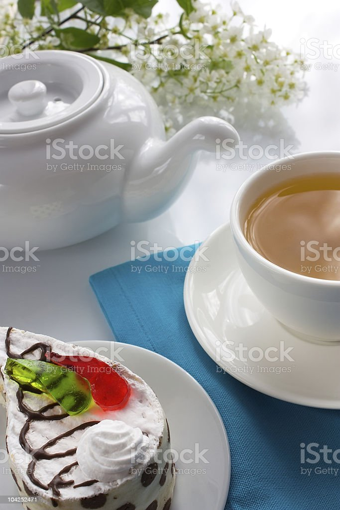 Cup of bird-cherry tea and sponge cake with jelly royalty-free stock photo