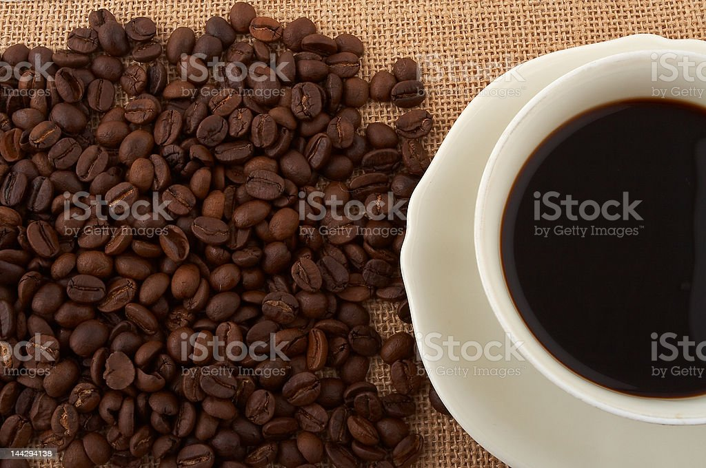 Cup of black coffee and beans royalty-free stock photo