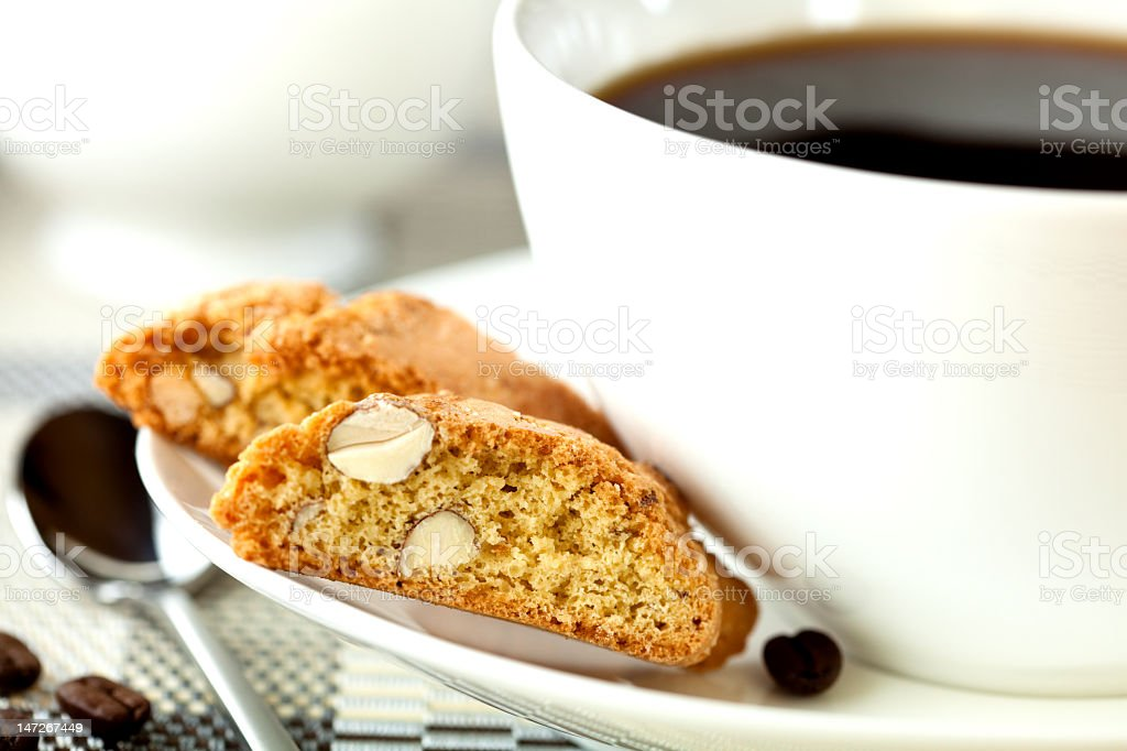 Cup of black coffee and cantuccini stock photo