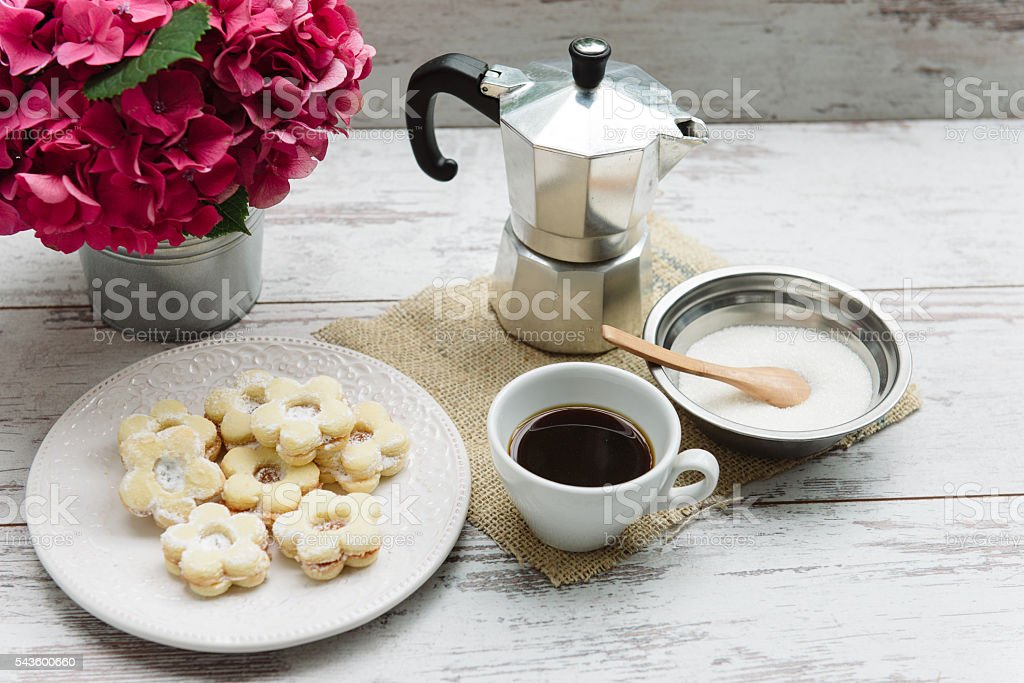 Cup of black coffee and cookies for tasty coffee break stock photo