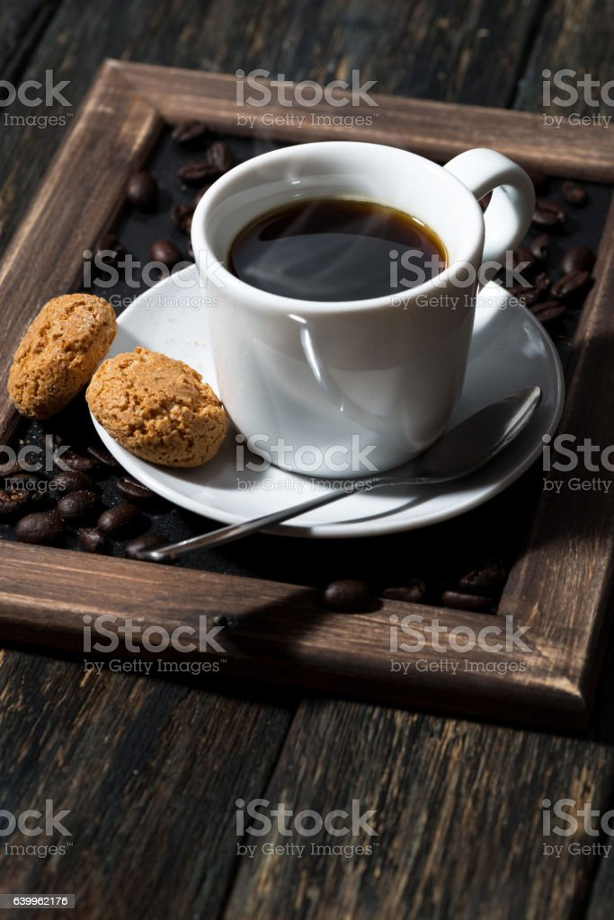 cup of black coffee and cookies on a wooden tray stock photo