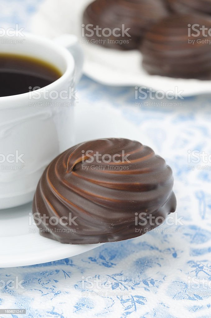cup of black coffee and marshmallows in chocolate, closeup stock photo