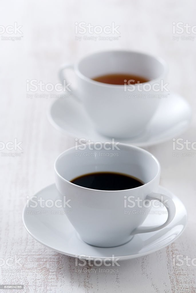 Cup of black coffee and tea stock photo