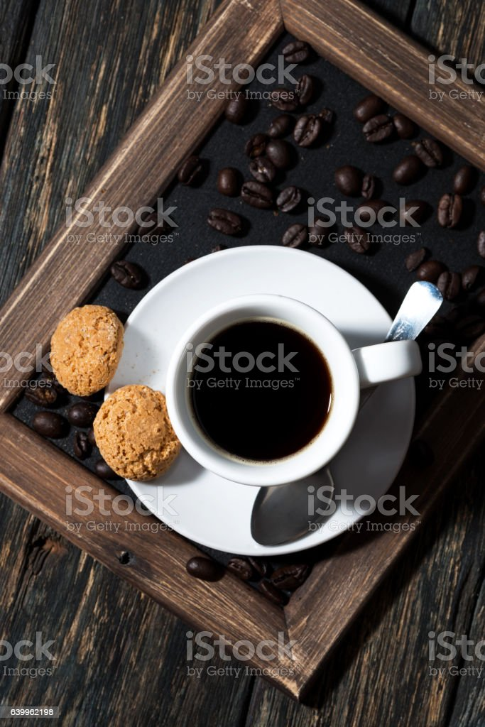 cup of black coffee on a tray, top view stock photo