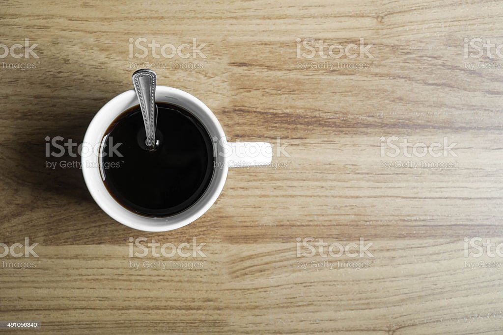 Cup of black coffee on wood background stock photo