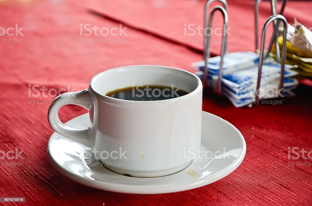 High Angle View Of white cup of black coffee