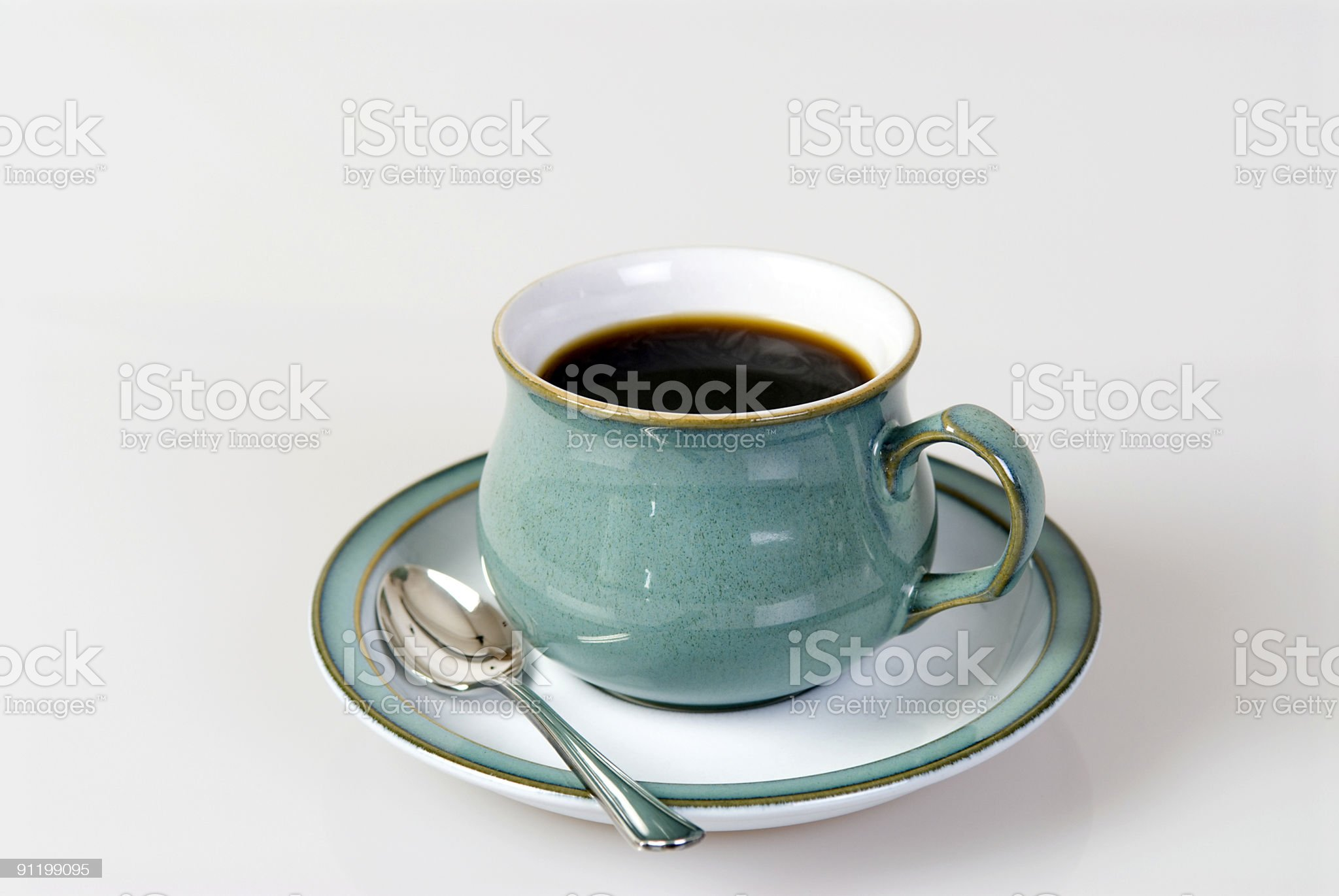 Cup of black coffee with a silver spoon royalty-free stock photo