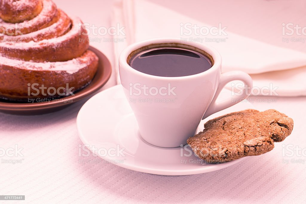 Cup of Black Coffee with a Sweet Bun and cookie royalty-free stock photo