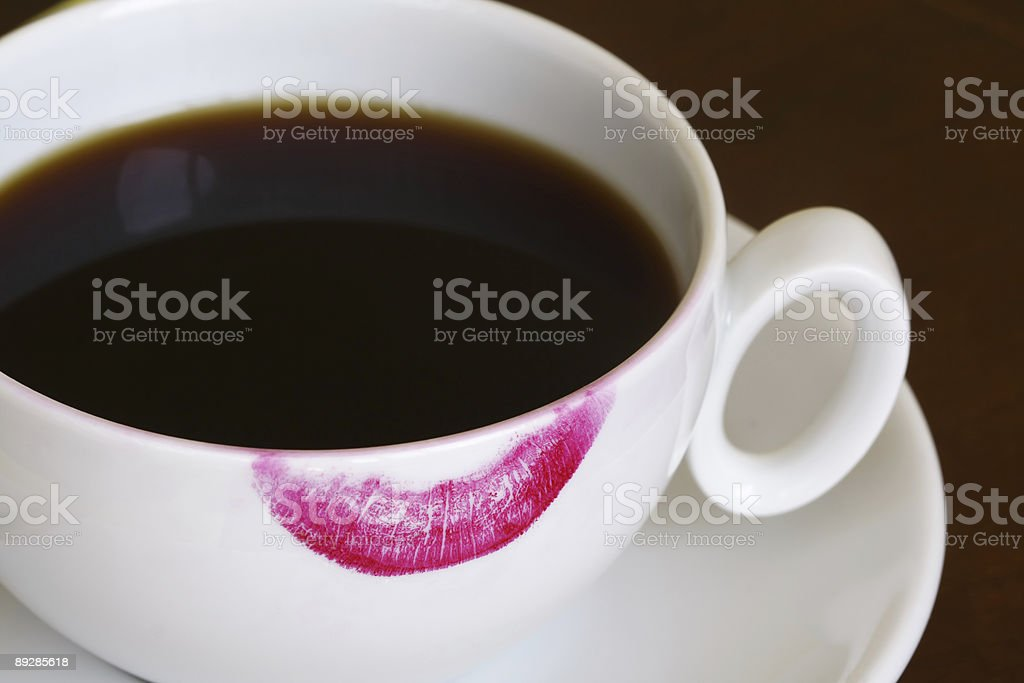 Cup of black coffee with lipstick print stock photo