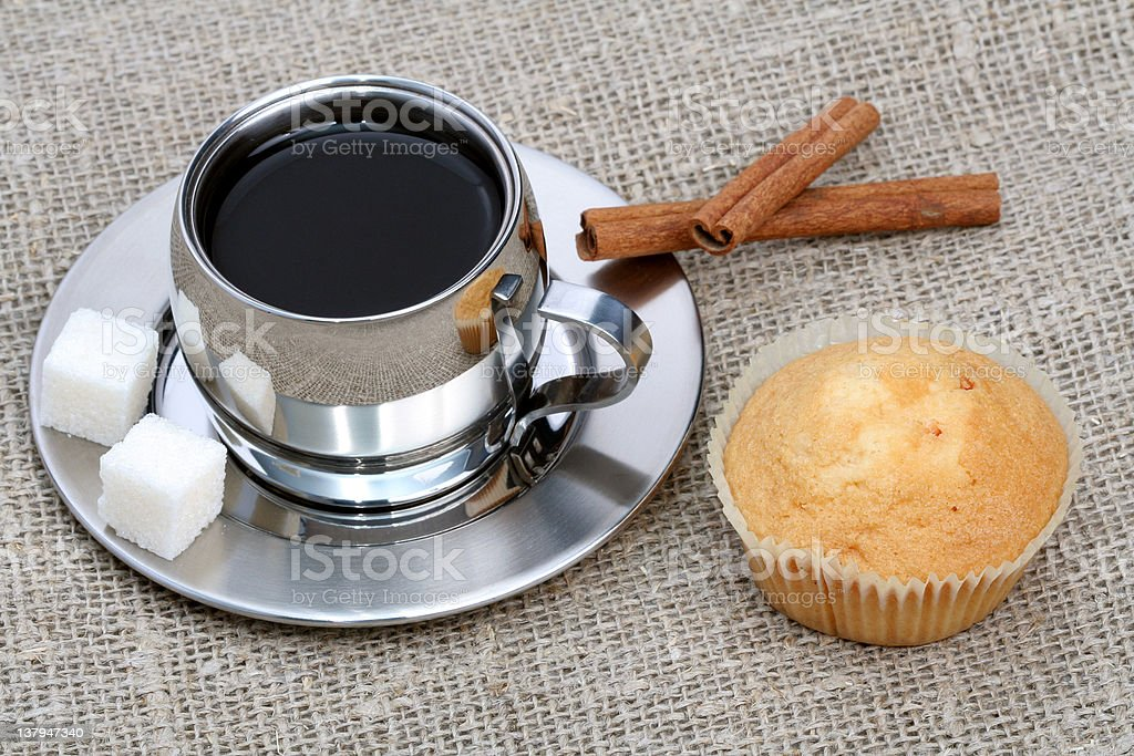 Cup of black coffee with muffin and cinnamon royalty-free stock photo