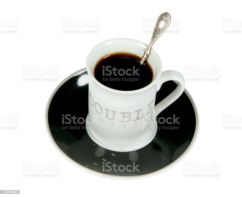 Cup of black coffee with the spoon royalty-free stock photo