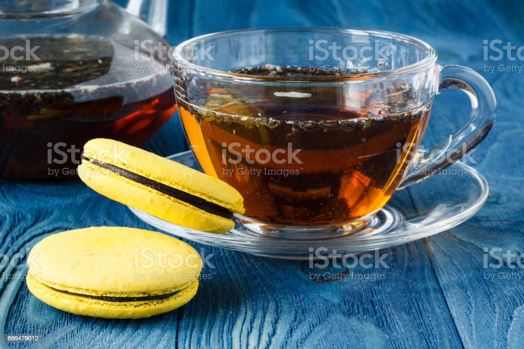 Cup of black tea with tasty almond cookies stock photo