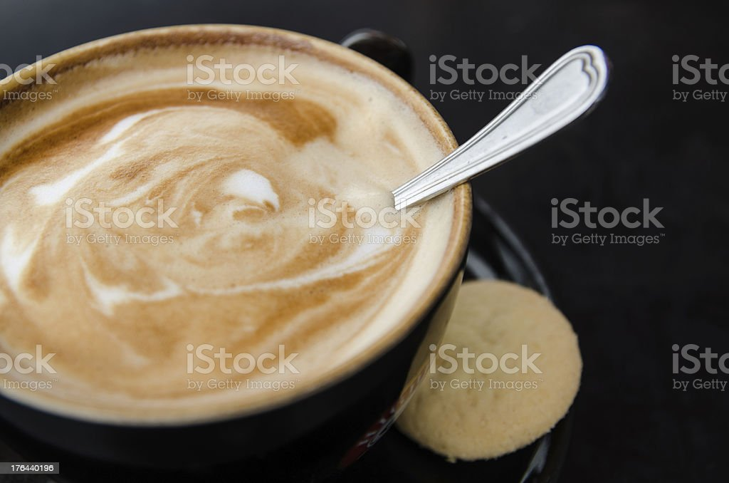 Cup of caffe crema with biscotti royalty-free stock photo
