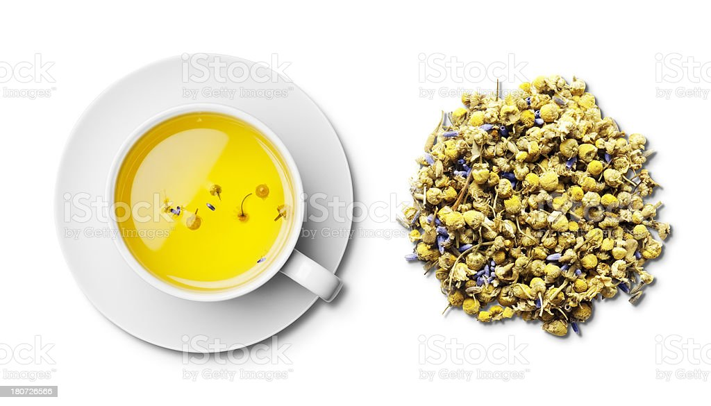 Cup of camomile and lavender tea and tea leaves overhead stock photo