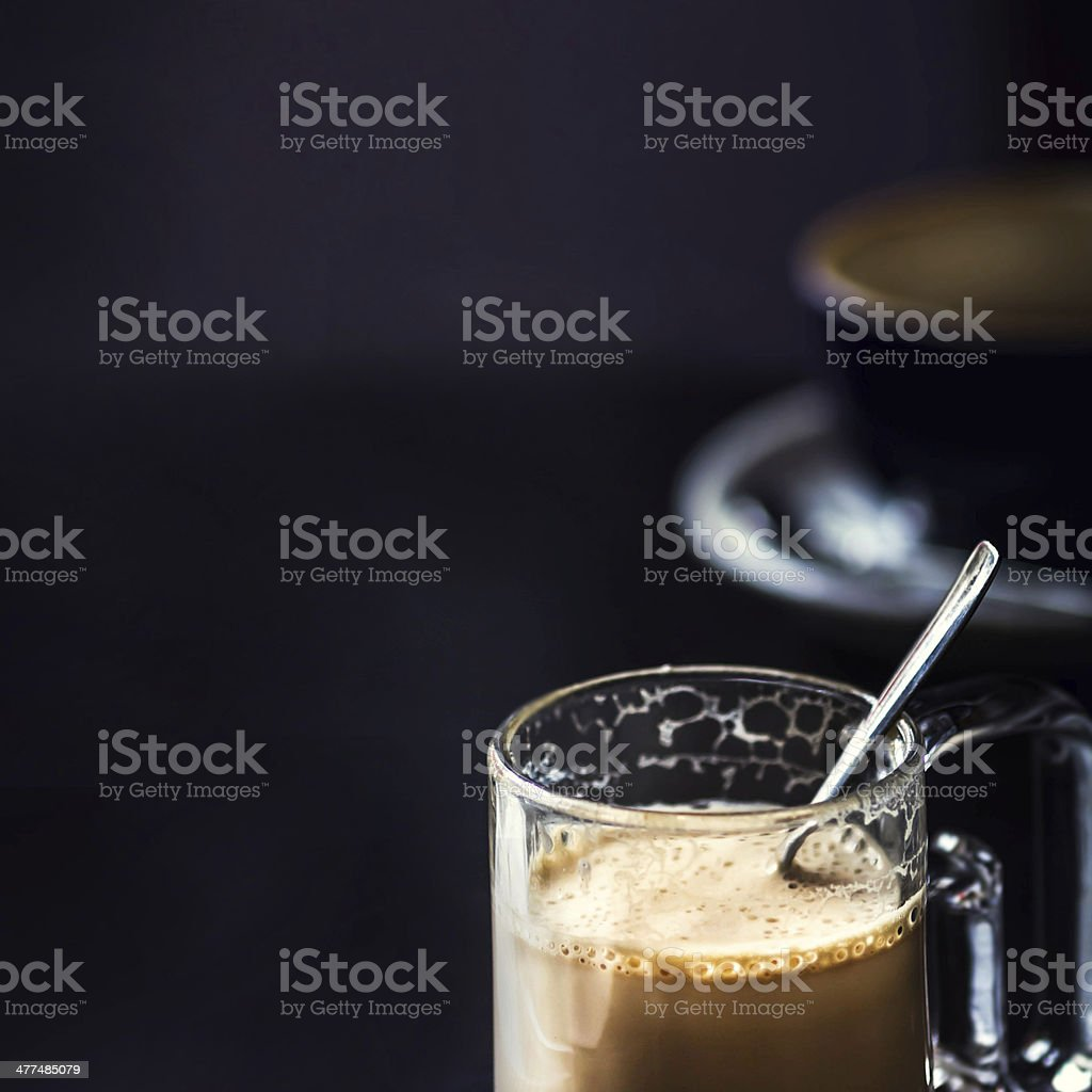 Cup of Cappuccino Coffee in Cafe on dark table stock photo
