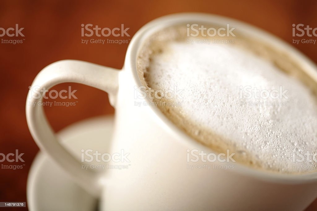 Cup of cappuccino coffee on wood table royalty-free stock photo