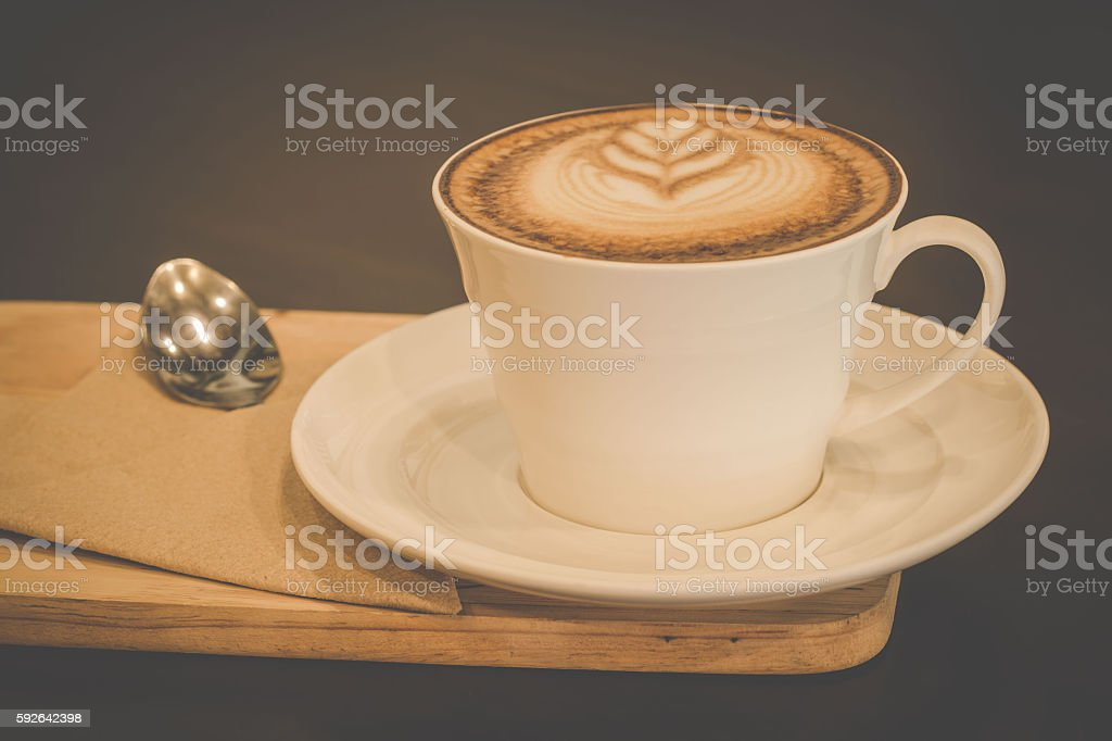Cup of cappuccino coffee on wooden background. stock photo