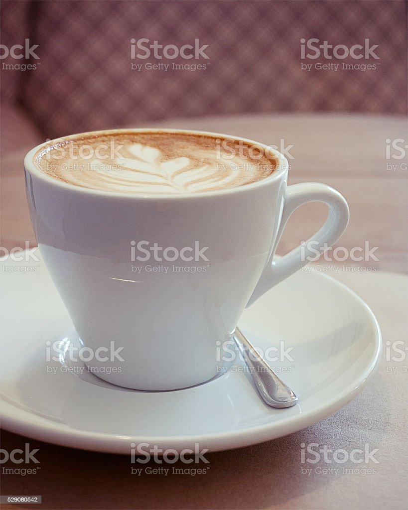 Cup of cappuccino, lo-fi effect stock photo
