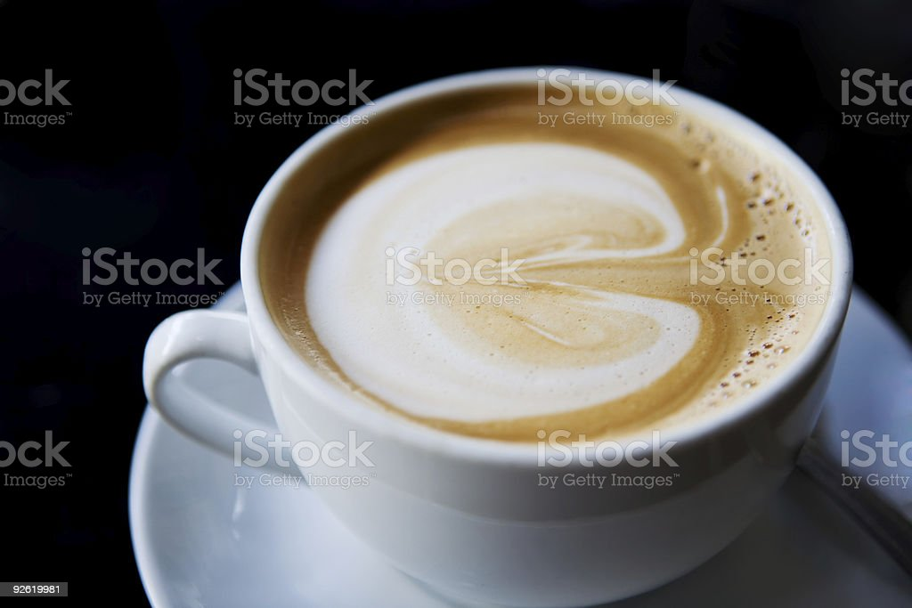 Cup of cappuccino on a white plate stock photo