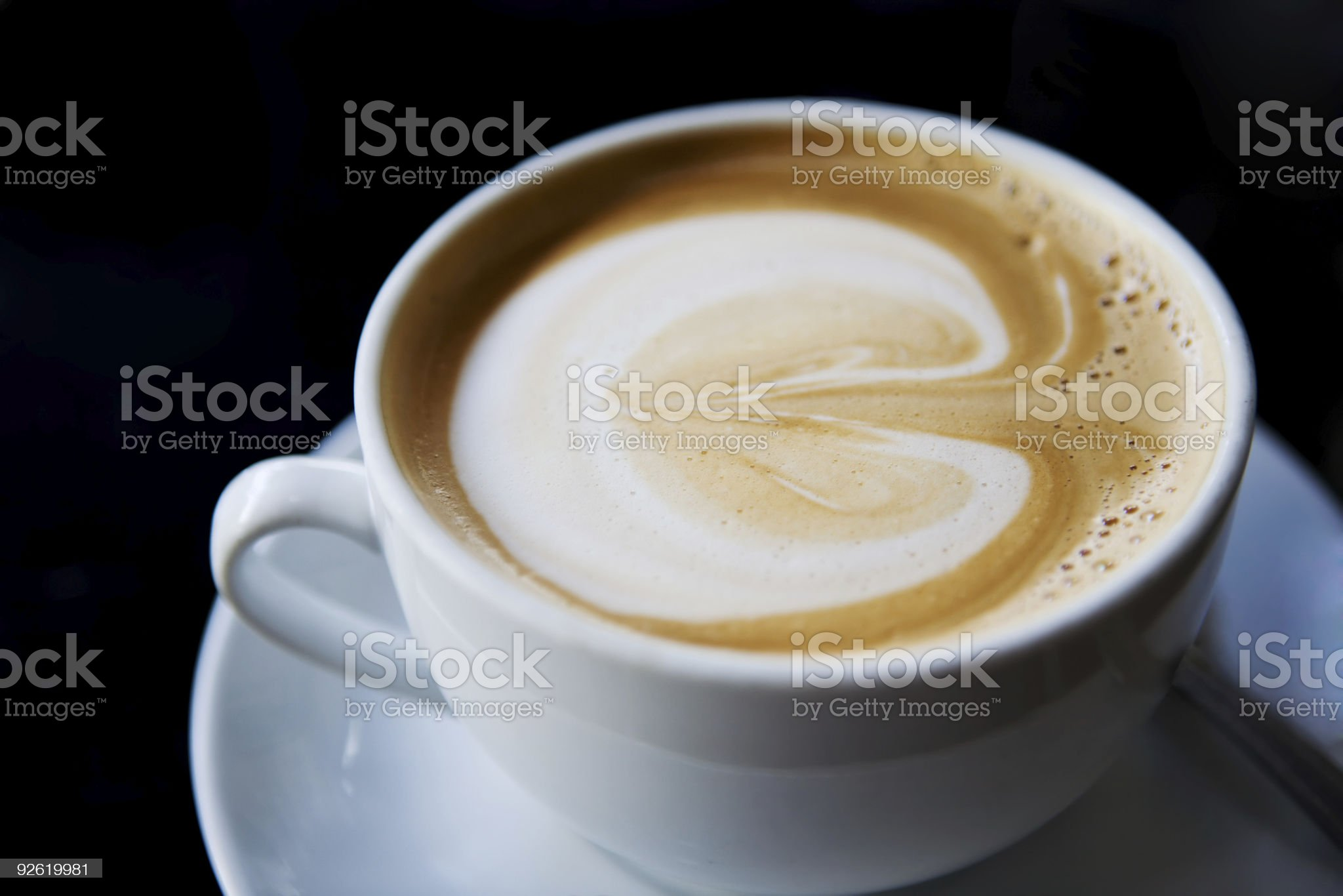 Cup of cappuccino on a white plate royalty-free stock photo