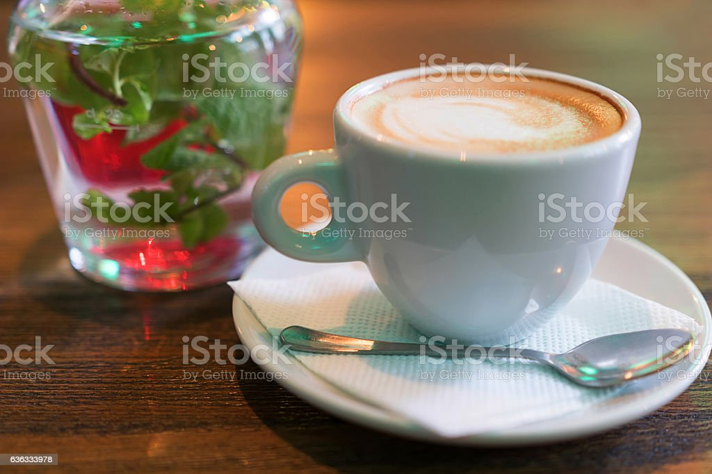 Cup of cappuccino on the table at the bar. stock photo
