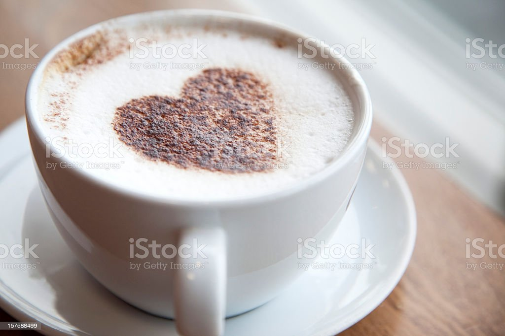 Cup of cappuccino with a heart design stock photo