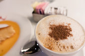 Cup of Cappuccino With Dessert