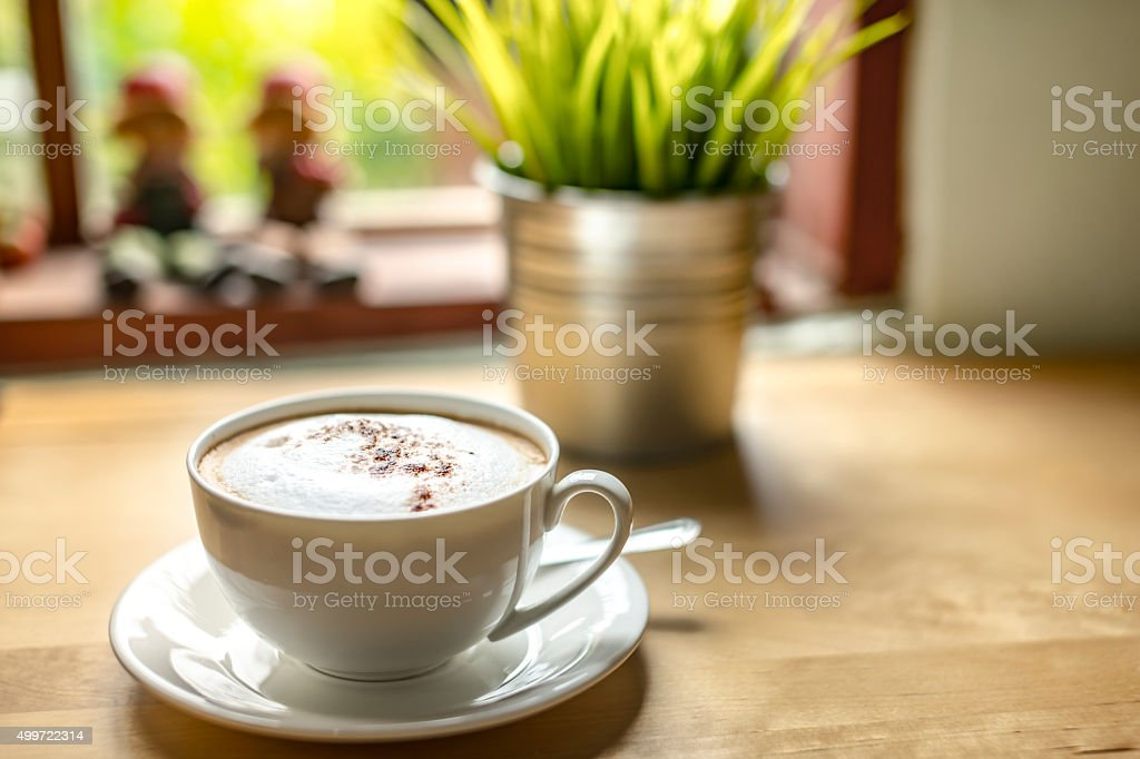 Cup of cappuchino on table. royalty-free stock photo
