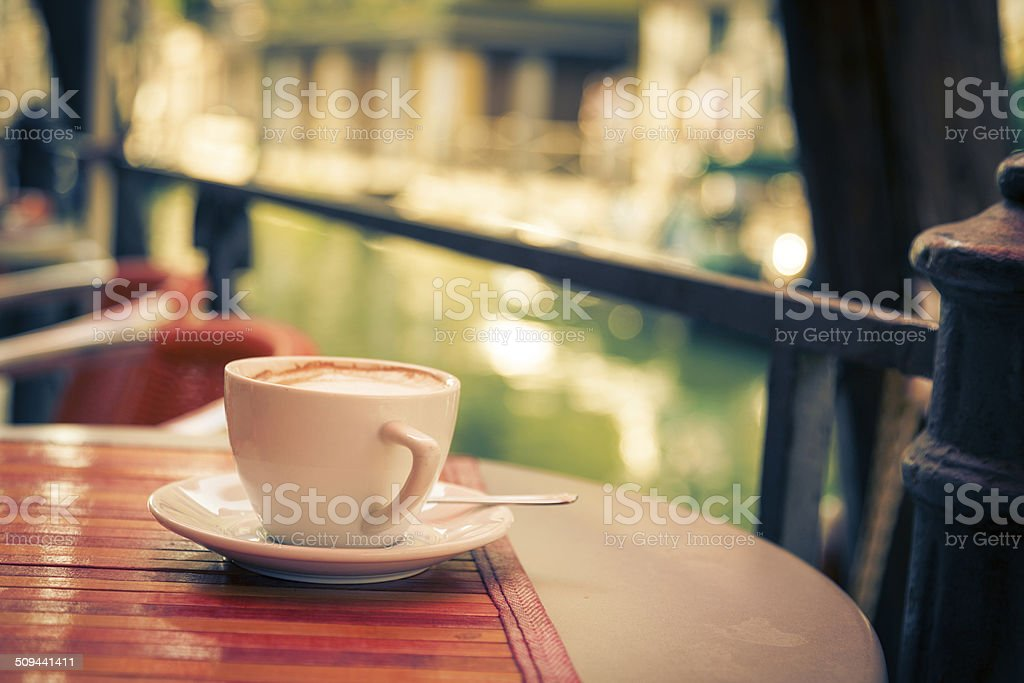 cup of cappucino in a venetian cafe stock photo