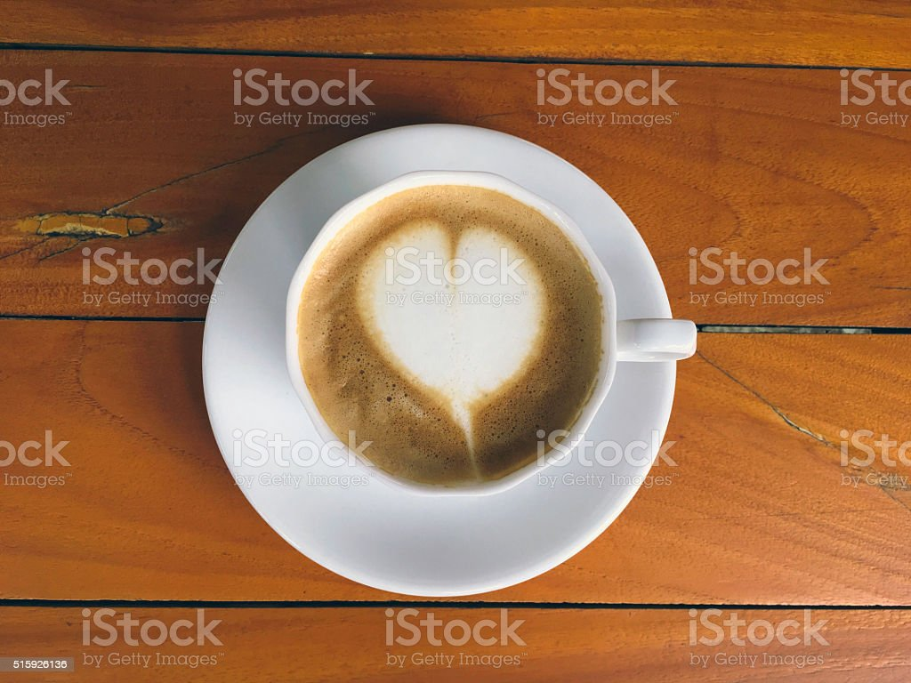 Cup of cappucino on a wood background royalty-free stock photo