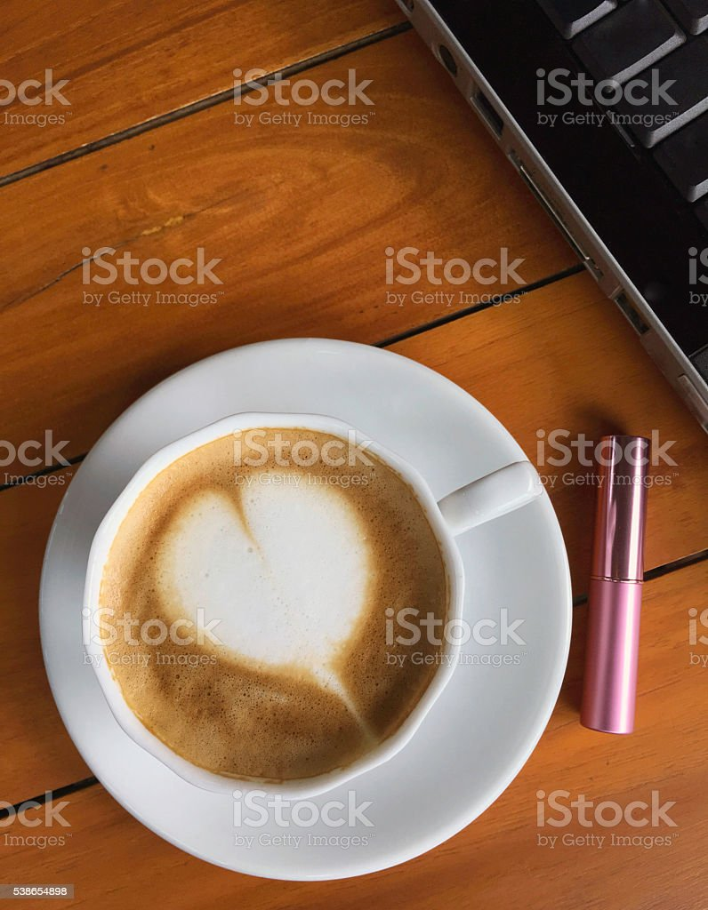cup of cappucino with pink lipstick and laptop royalty-free stock photo