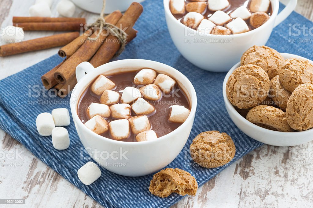 cup of cocoa with marshmallows and almond cookies stock photo