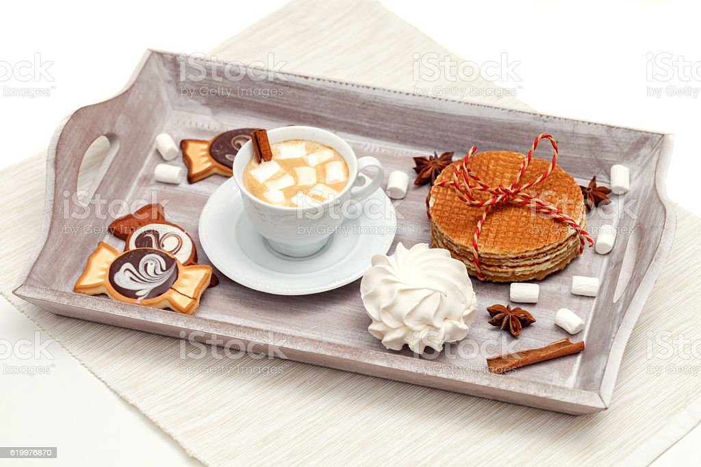 Cup of cocoa with marshmallows and sweet treats stock photo