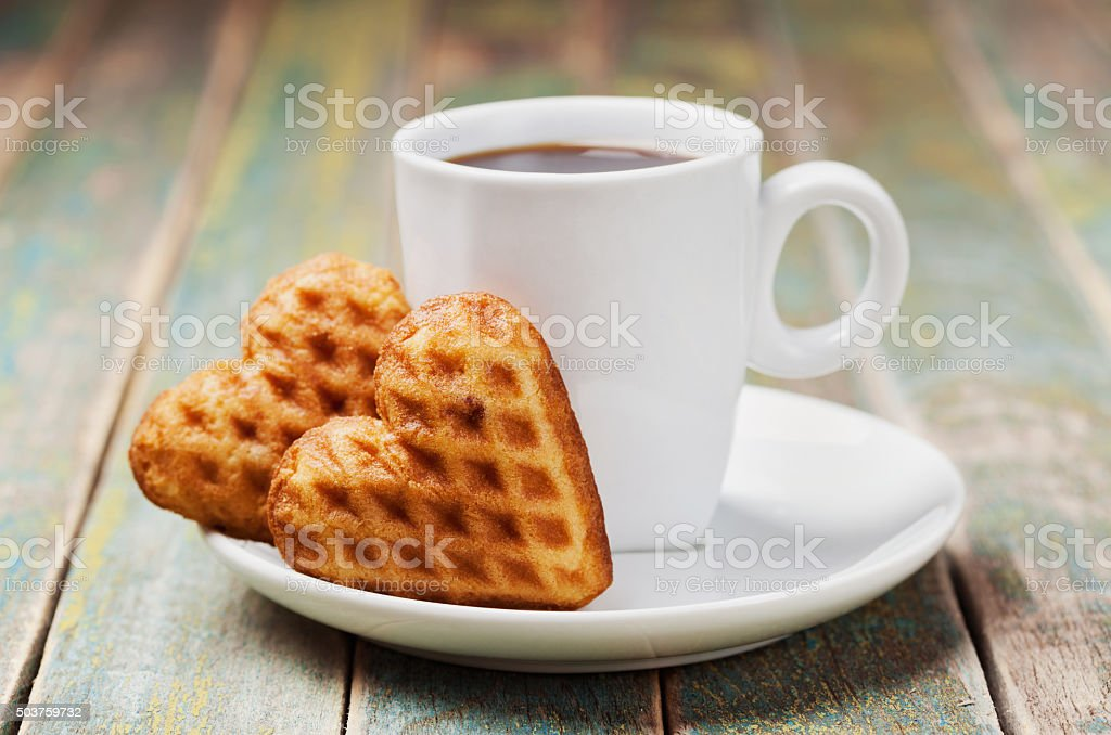Cup of cofee with waffle biscuits for Valentines day stock photo