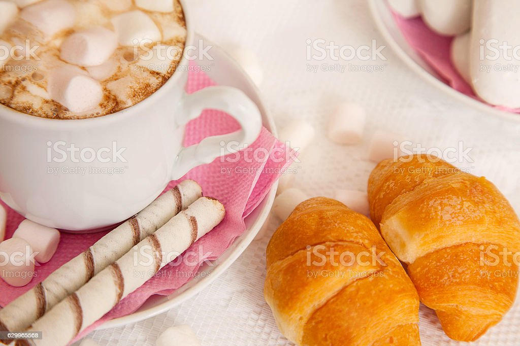 cup of coffe with marshmallow and croissants royalty-free stock photo