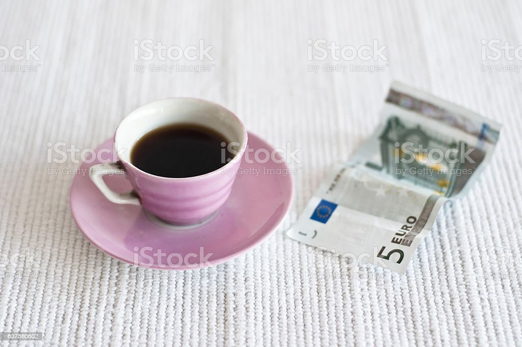 Cup of coffee and 5 euro note stock photo