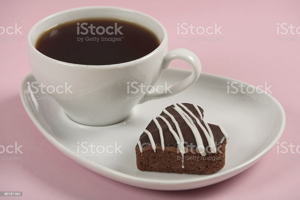 Cup of coffee and a cake on pink bacground royalty-free stock photo