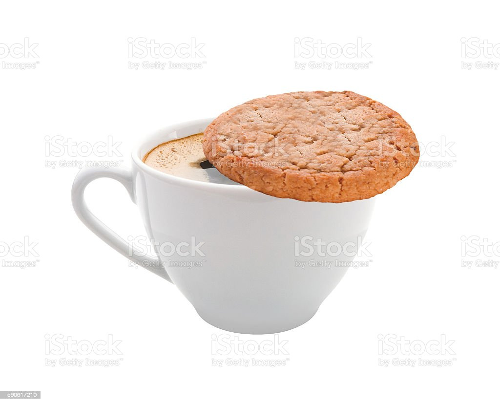 Cup of coffee and a cookie stock photo