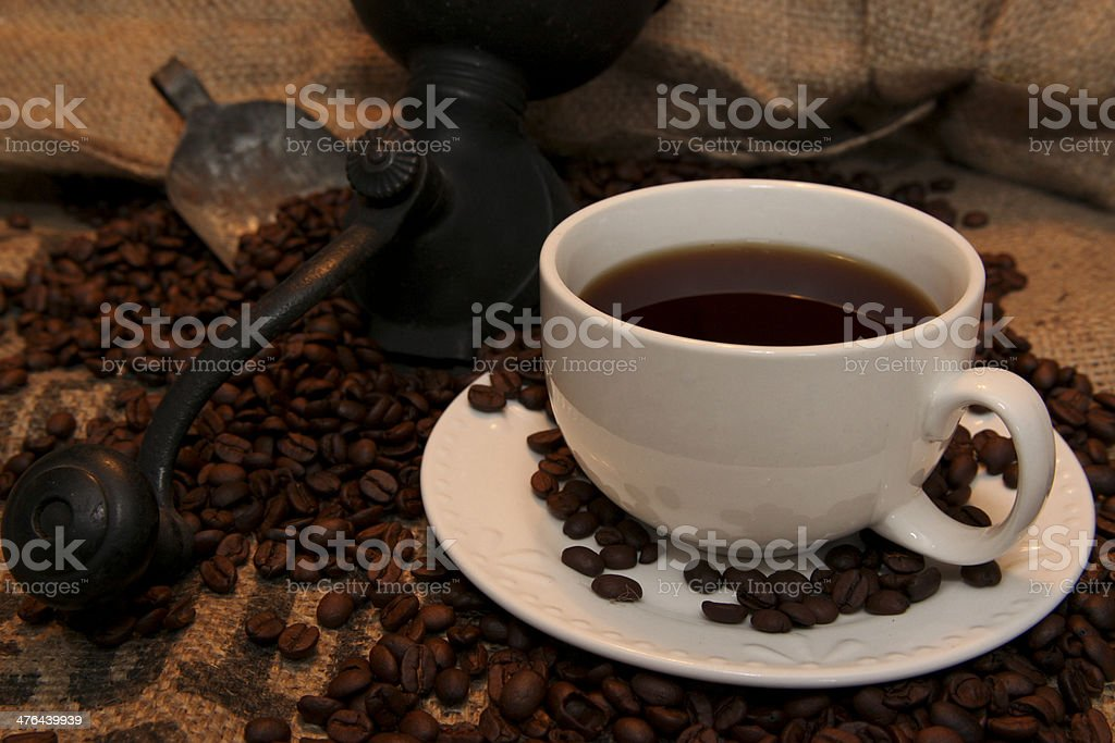 Cup of Coffee and Antique Bean Grinder royalty-free stock photo