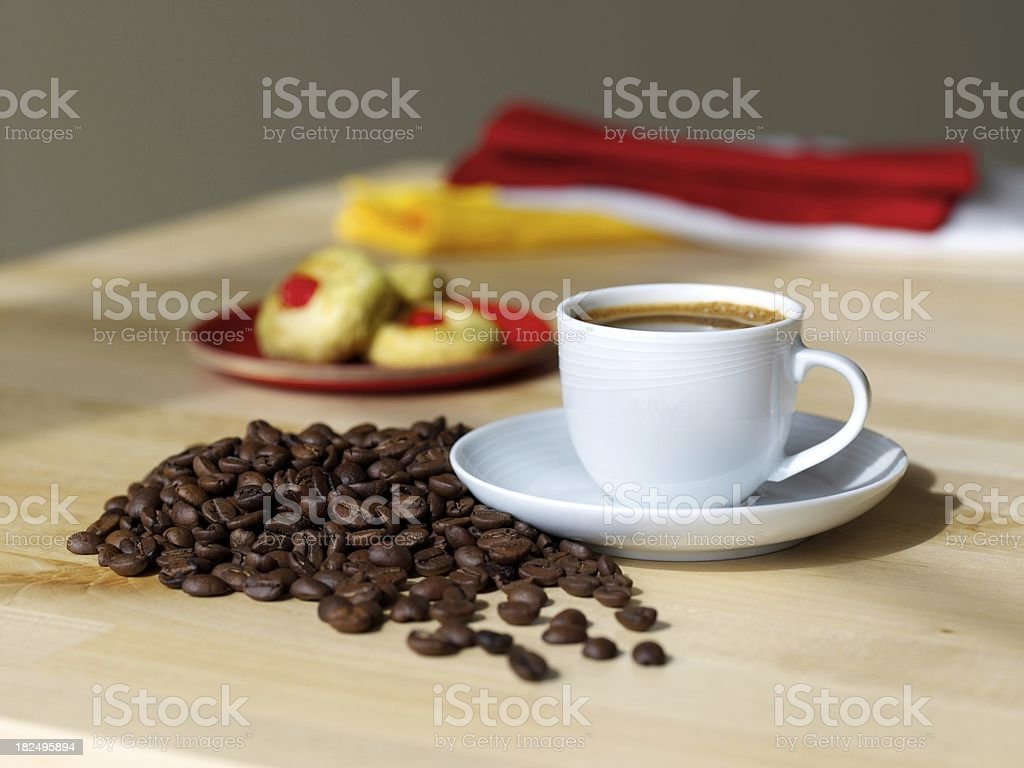 Cup of coffee and bean royalty-free stock photo