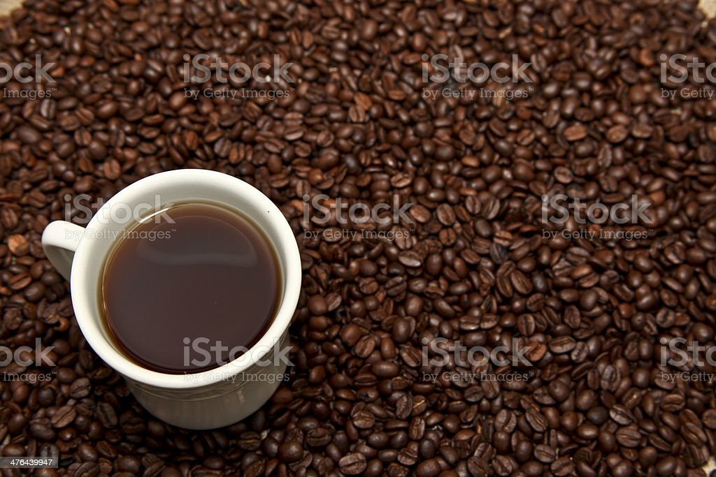 Cup of Coffee and Beans royalty-free stock photo