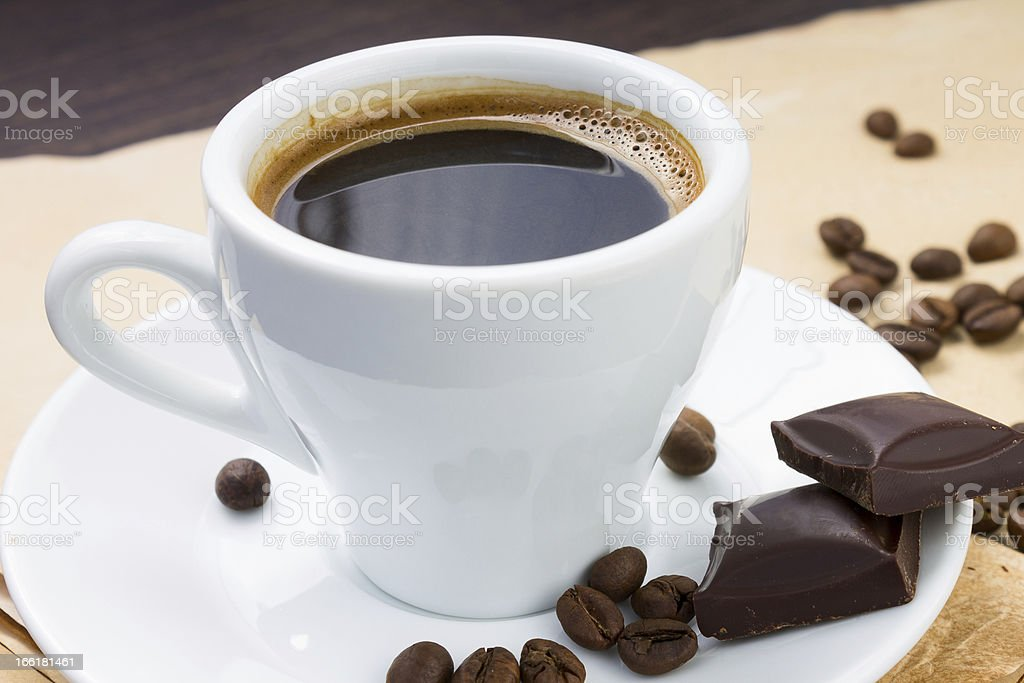 Cup of coffee and beans with chocolate royalty-free stock photo