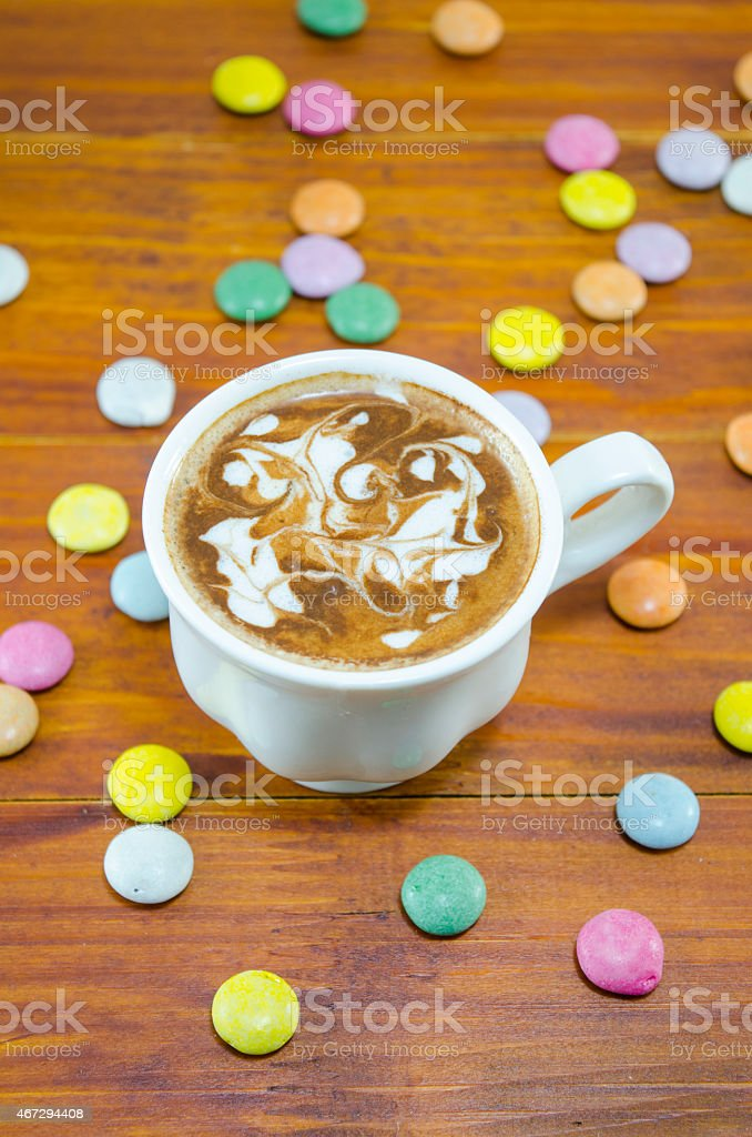 Cup of coffee and bombons of various colors royalty-free stock photo