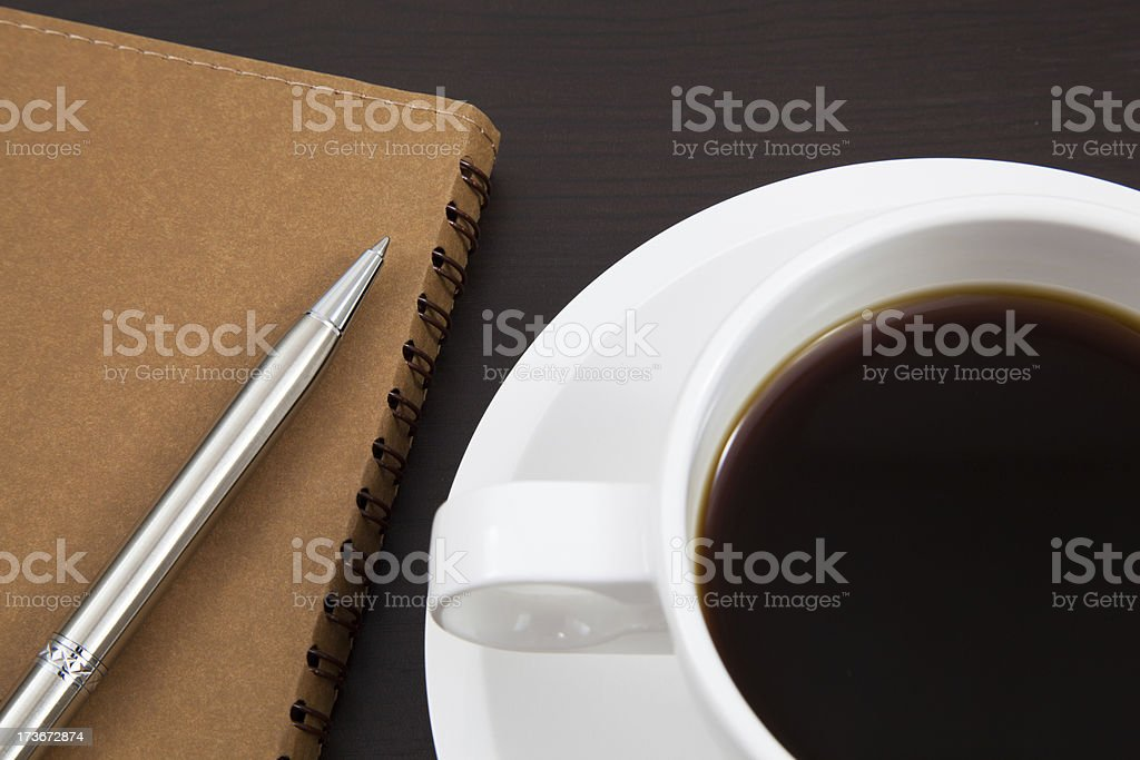 Cup of coffee and book royalty-free stock photo
