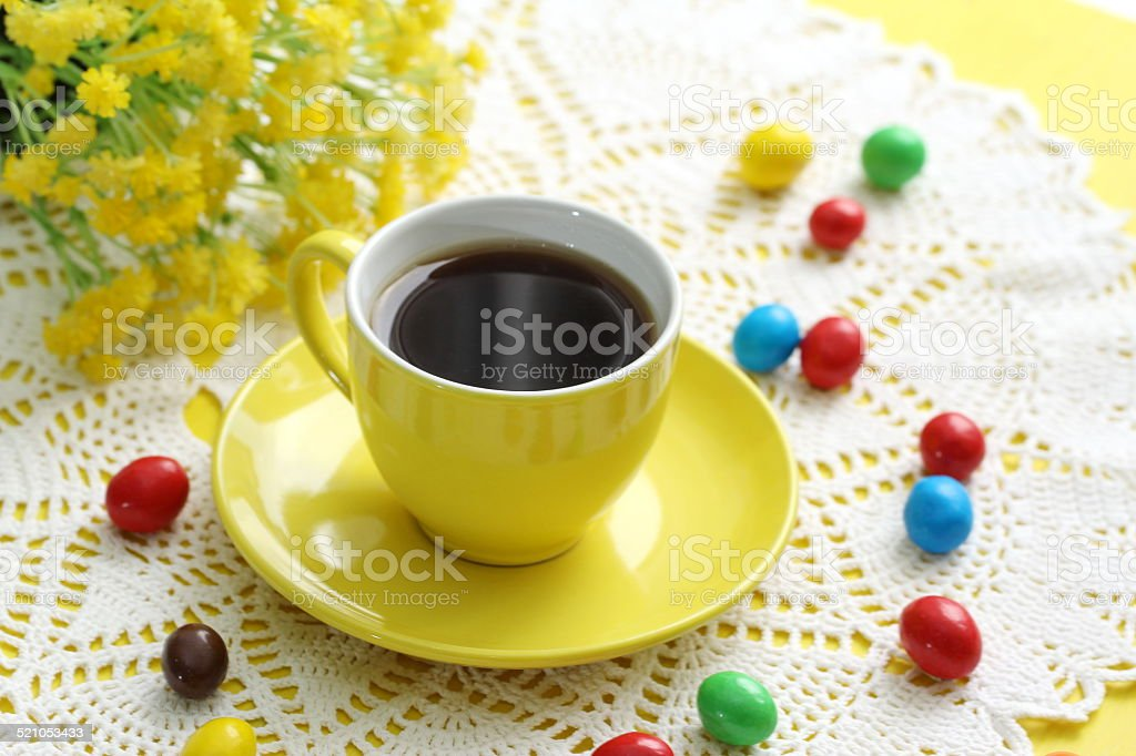 Cup of coffee and candeis stock photo