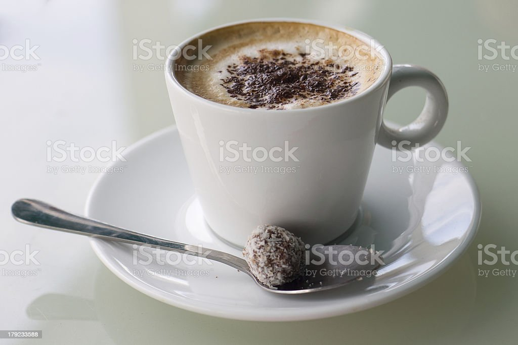 Cup of Coffee and candy royalty-free stock photo