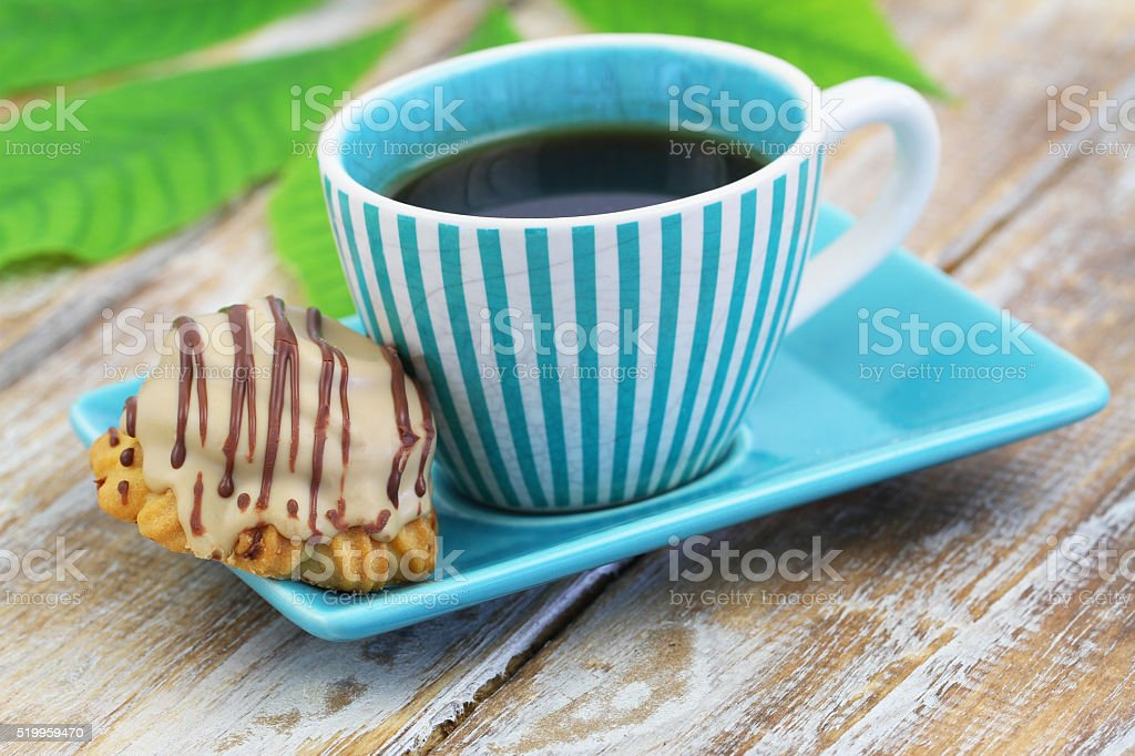 Cup of coffee and chocolate and toffee cookie stock photo