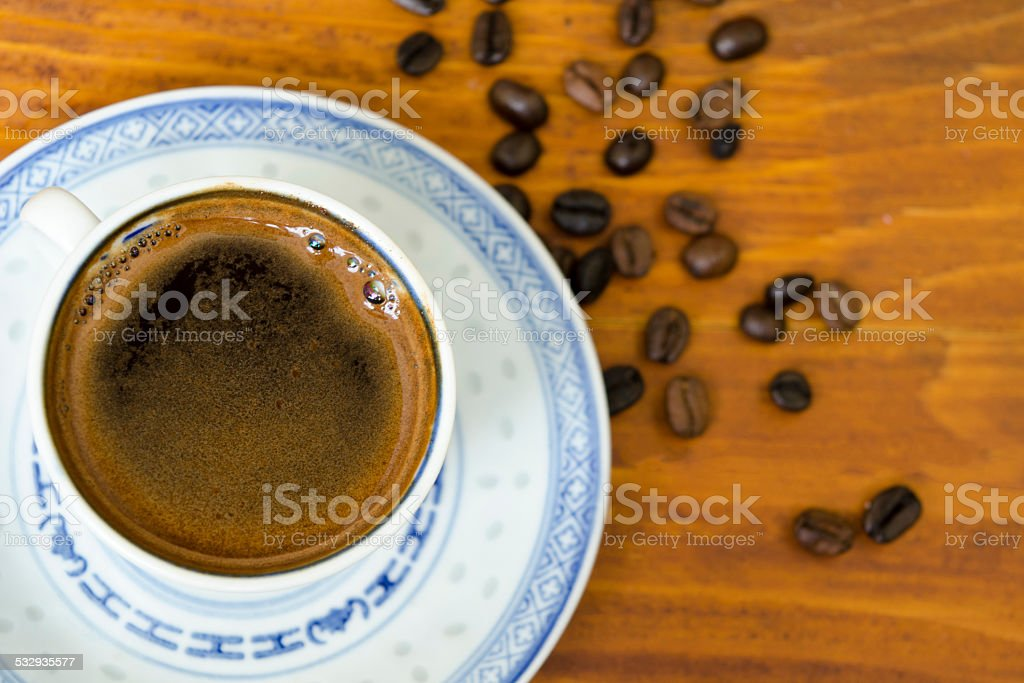 Cup of coffee and coffee beans royalty-free stock photo