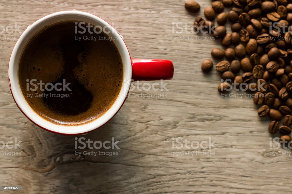 Cup of coffee and coffee beans viewed from directly above stock photo